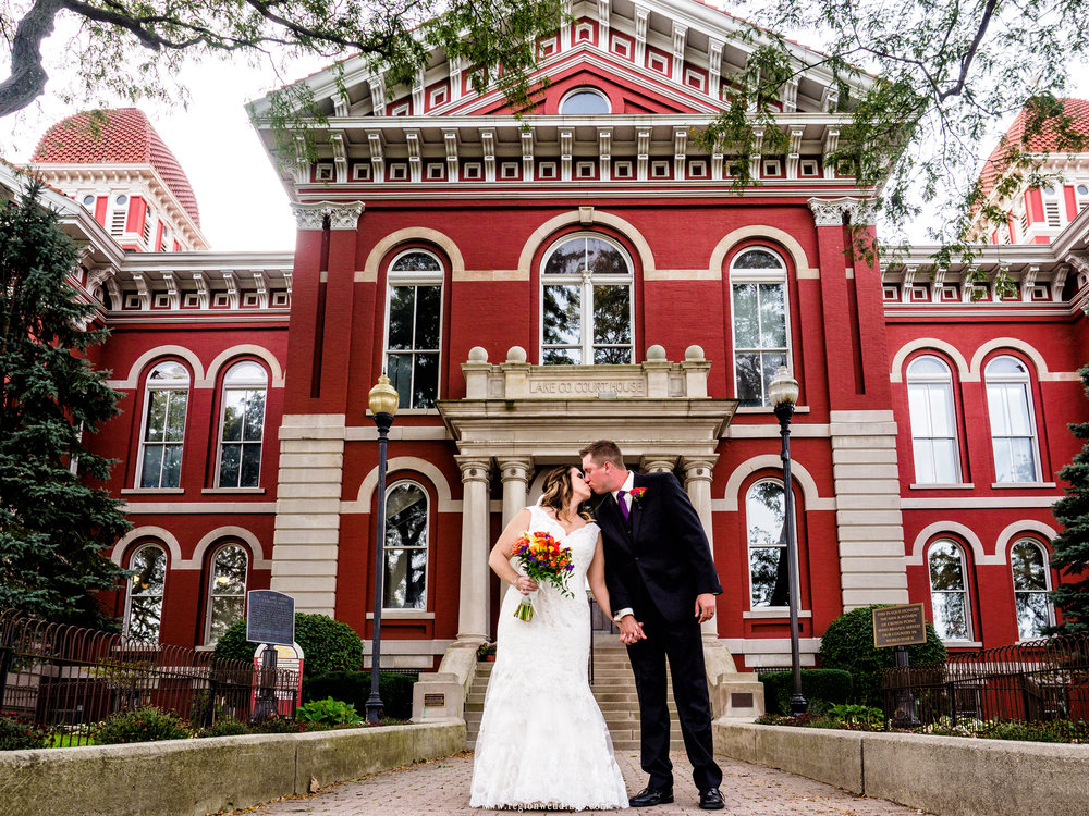Romantic kiss in front of The Grand Old Lady in Crown Point, Indiana.
