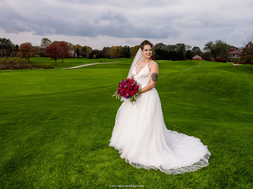 Bride and the beautiful greenery of Sand Creek Golf Course.