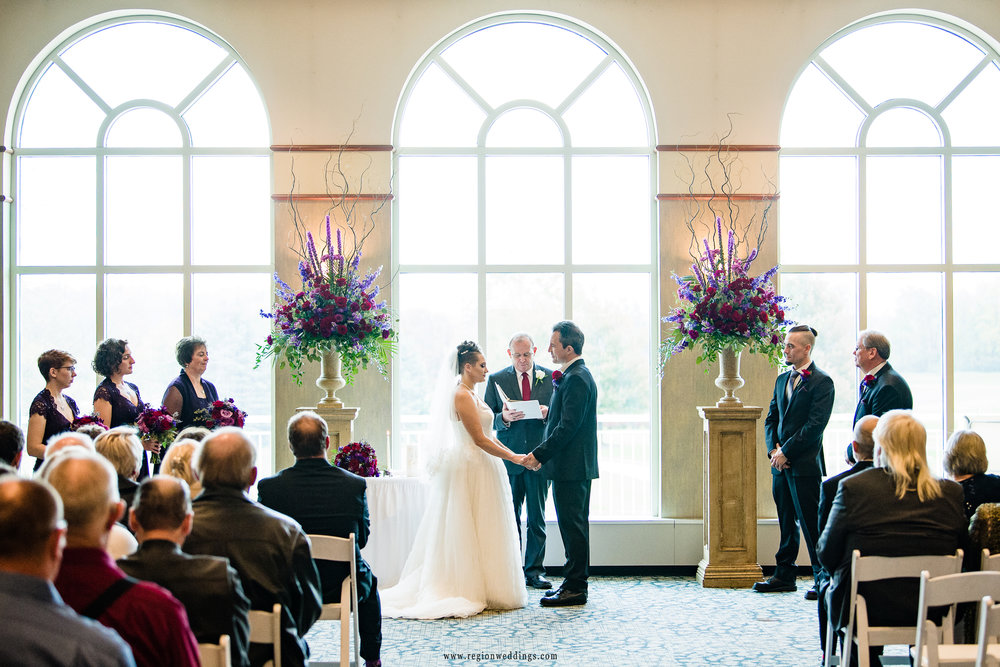 Bride and groom exchange vows at Sand Creek Country Club.