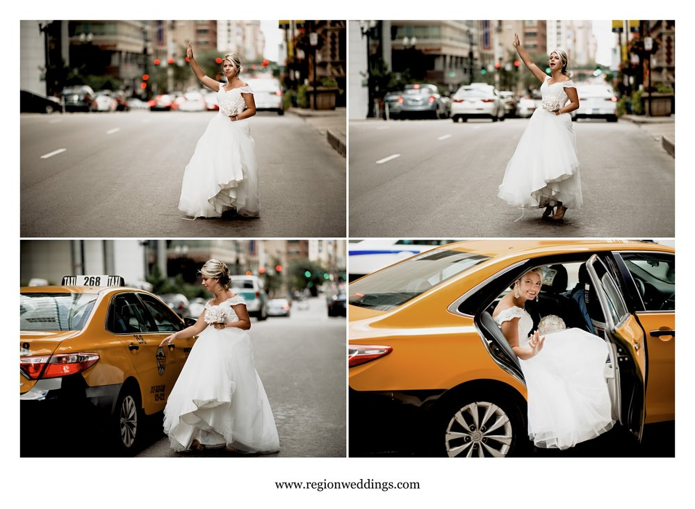 A bride hails herself a taxi on the streets of Chicago.