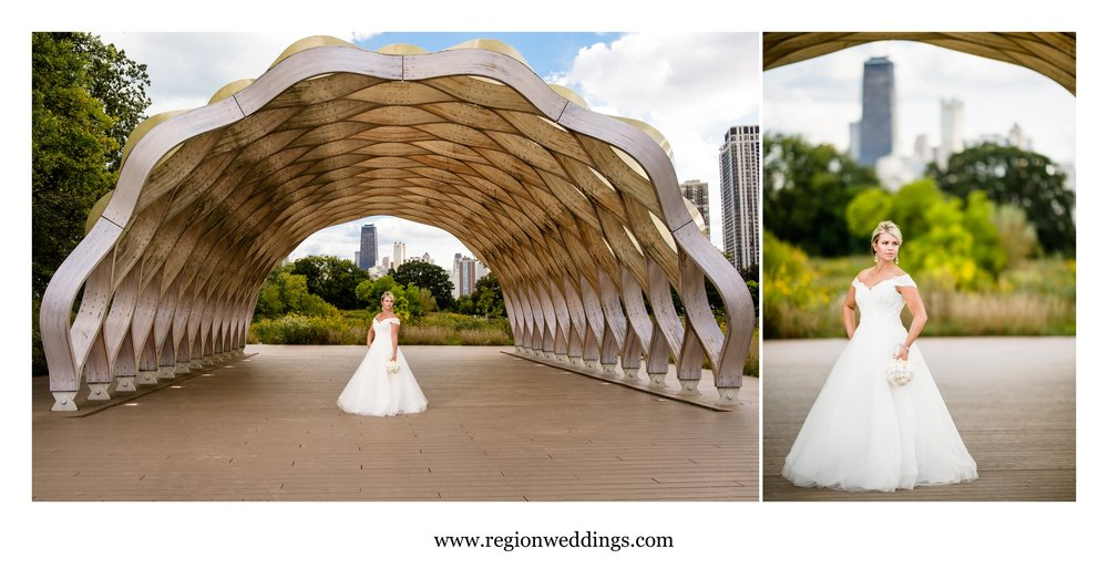 Bride in Lincoln Park Zoo with a view of the city of Chicago.