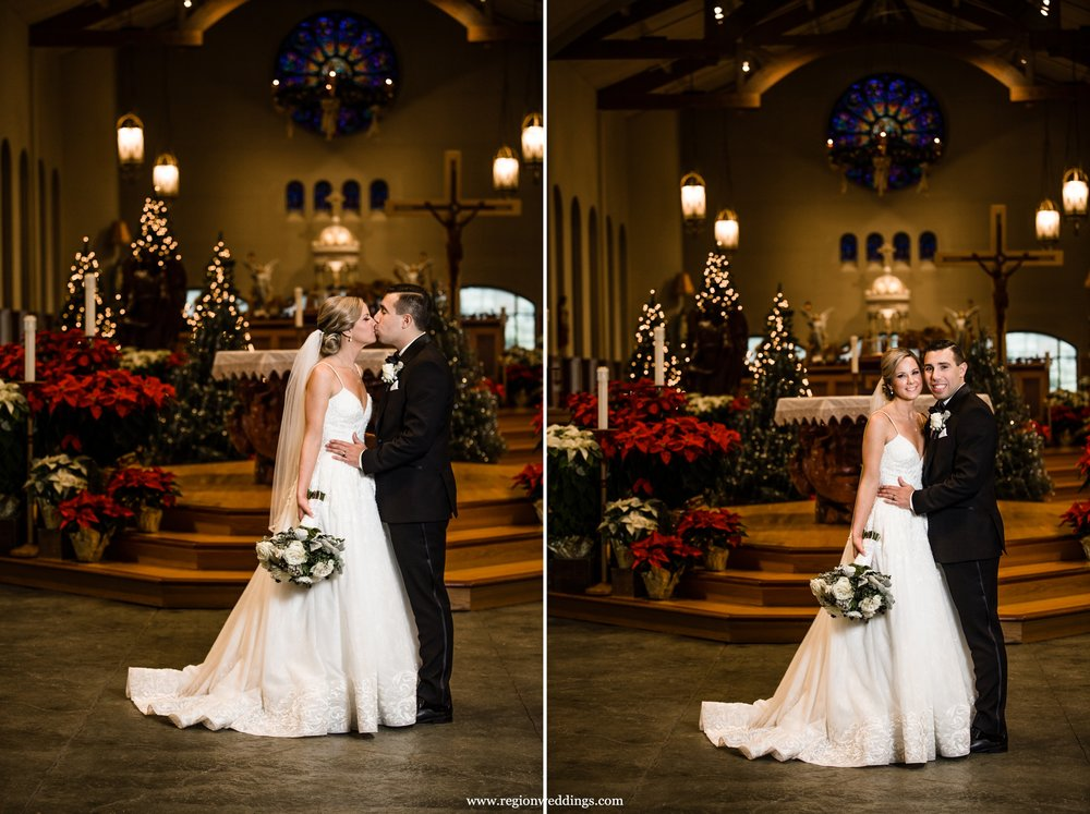 Bride and groom church portraits with Christmas decorations.