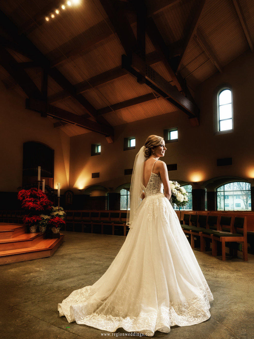 The bride shows off her pretty wedding dress at St. Michael's Parish.