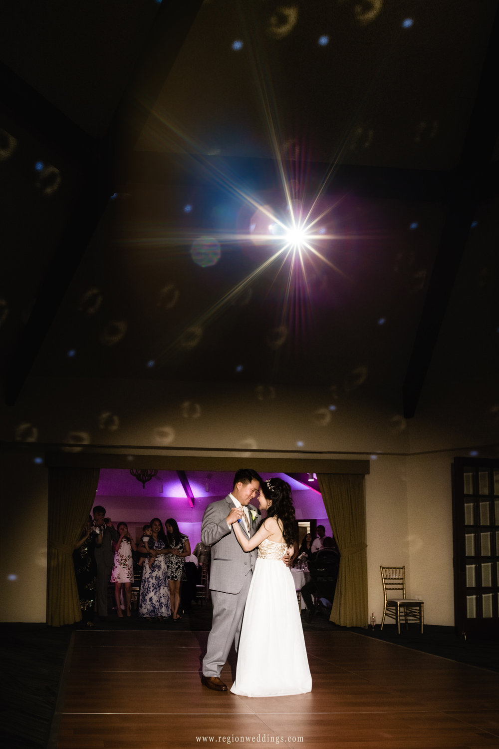 First dance for the bride and groom as romantic lighting engulfs the dance floor.