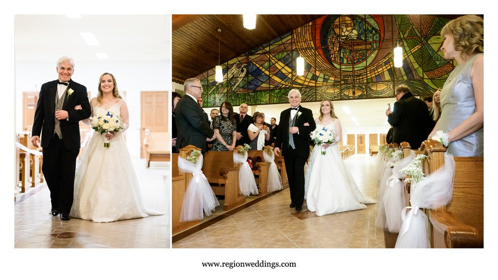 Father of the bride walks his daughter down the aisle at Carmelite Fathers church.