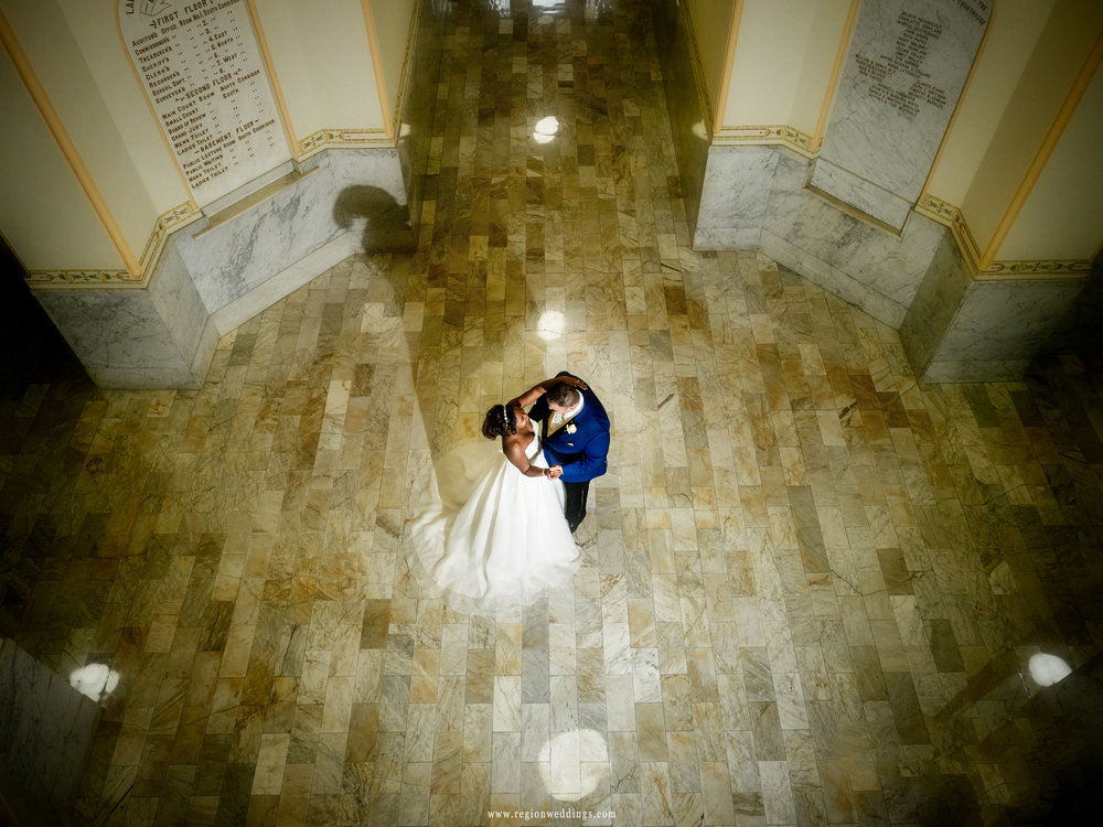 Bride and groom dance within the elegant first floor of the Old Crown Point Courthouse.