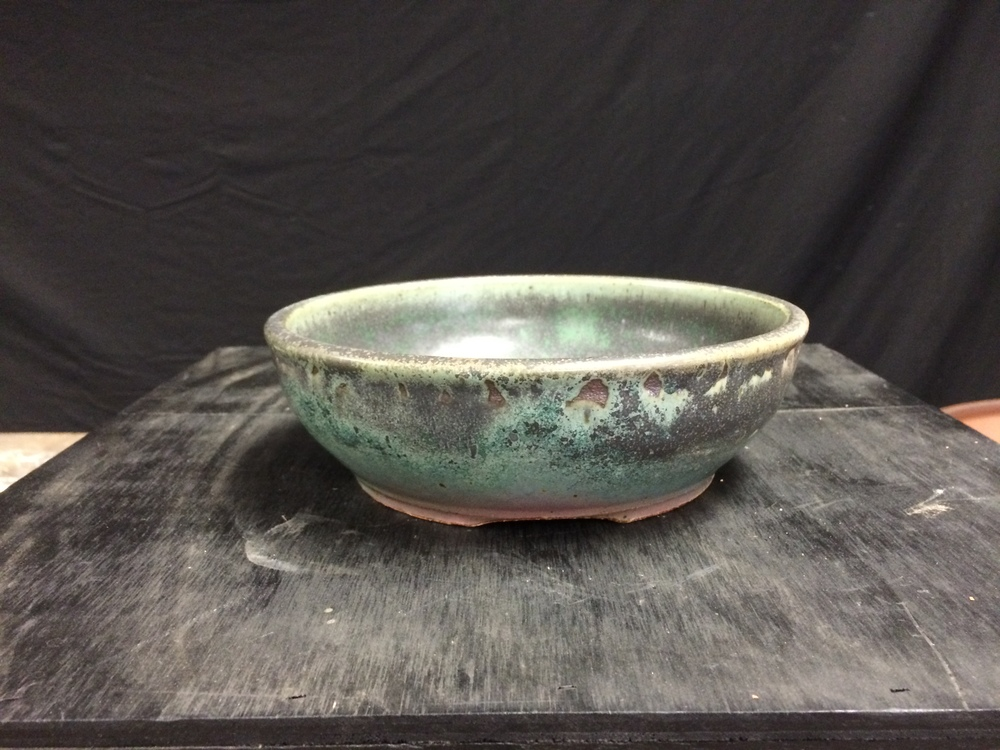 A wonderful glazed round pot by Sharon. The finish is different all around the pot. Yum!