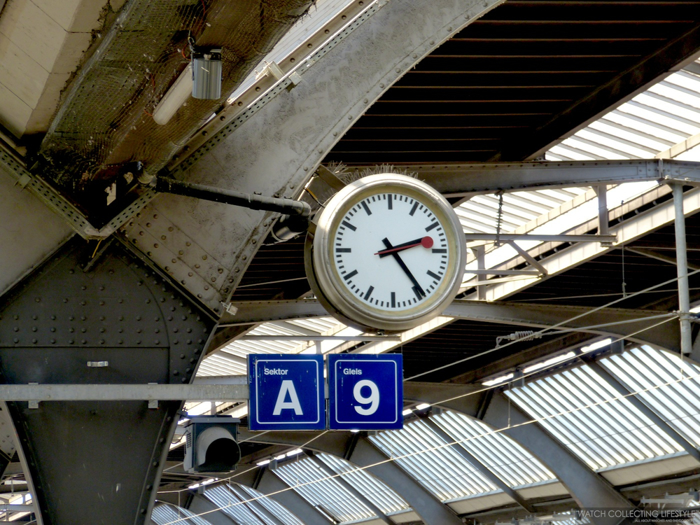 One of the famous Mondaine clocks at the train station. All train stations in Switzerland are stocked with Mondaine clocks.