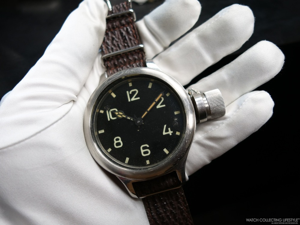 World War II Russian Diver's watch with screwed-in crown protector. Still running strong.