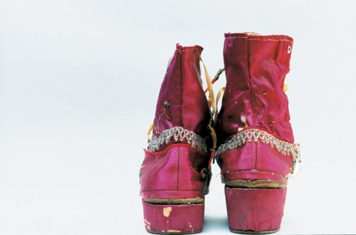 Kahlo's fringed boots, the right one with a stacked heel