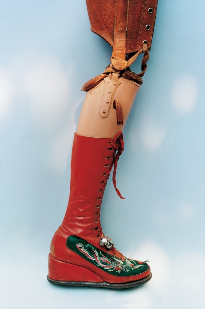 Kahlo's leg was amputated in 1953. She designed this prosthetic leg with embroidered red lace-up boots and a bell attached