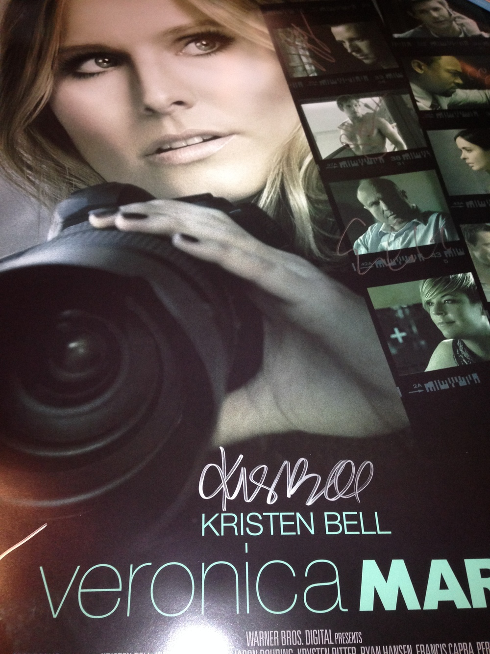 The luminous Kristen Bell kicking A and taking photos