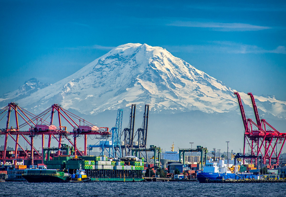 Mt. Rainier @ 14,411 ft hovers over the dockyards near downtown Seattle.