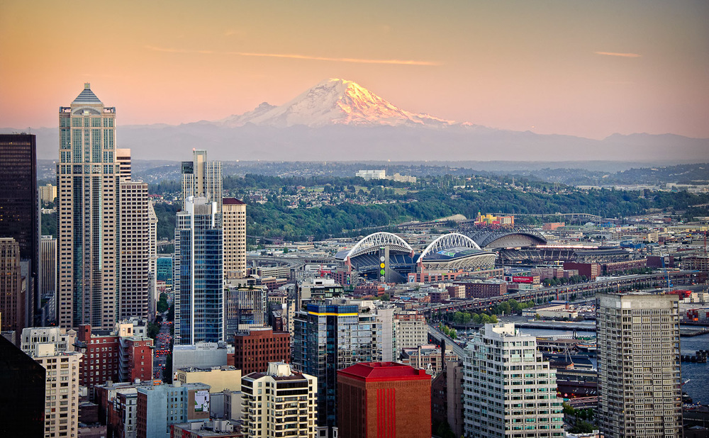 Sun sets over Seattle with Mt. Rainier in the background.  This was taken from the Space Needle.