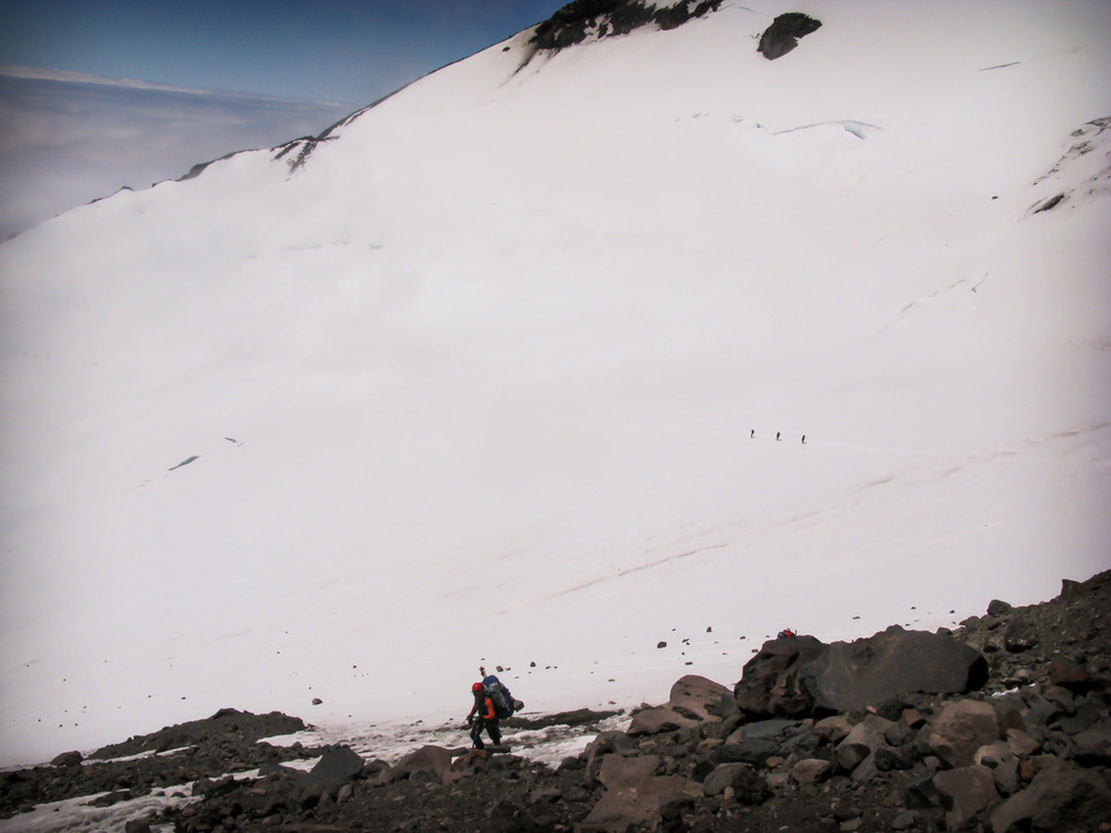 Looking down to the traverse across Cowlitz Glacier from Cathedral Gap
