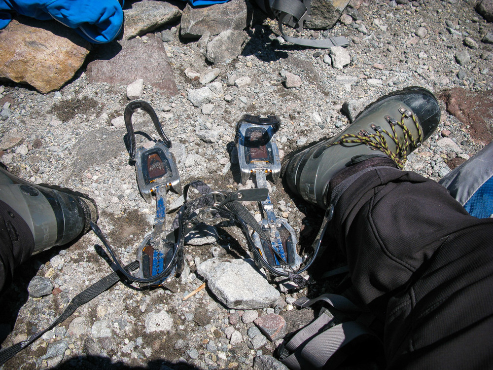 Taking the crampons off after getting back to Camp Muir from the summit