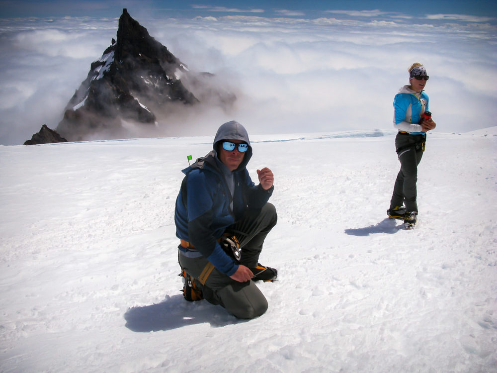 Our guides Jeff and Solveig taking a break on the Ingraham Flats after leading us down the Disappointment Cleaver