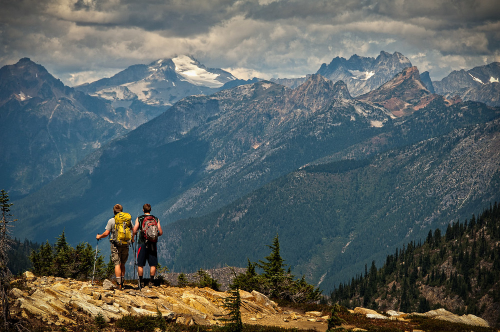 Hikers enjoying the amazing panoramic views of the North Cascades from Sourdough Mountain.