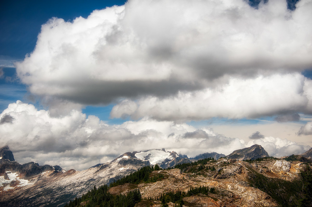Puffy white clouds envelop the peaks of the North Cascades.