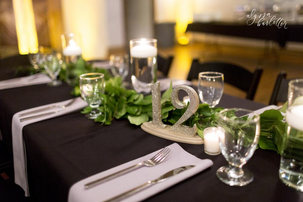 lawrence kansas wedding photography centerpiece table reception black pink greens liberty hall