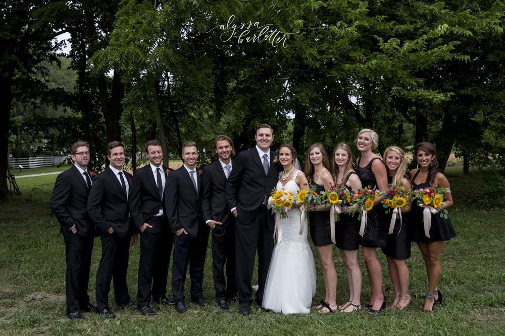 kansas city wedding budget mahaffie bridal party black suits dress sunflowers groomsmen bridesmaids bride groom