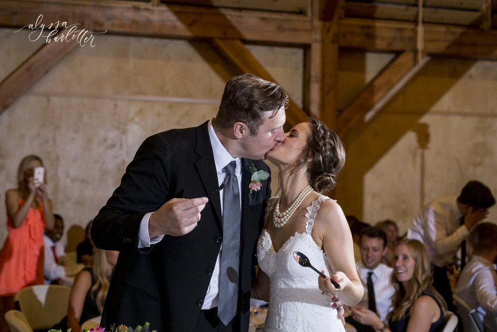 kansas city wedding budget mahaffie cake cutting kiss bride groom reception