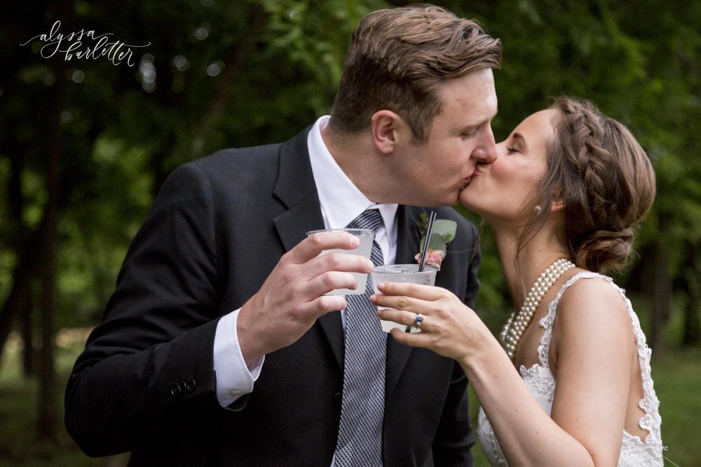 kansas city wedding budget mahaffie bride groom kiss signature cocktail
