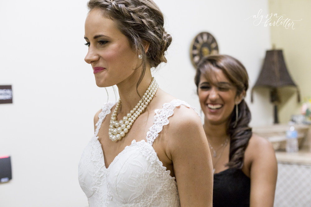 kansas city wedding budget mahaffie bride getting ready dress