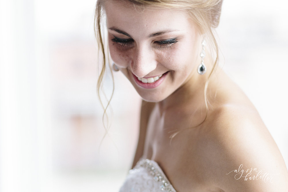 kansas city wedding photographer redeemer midtown bride getting ready dress earrings
