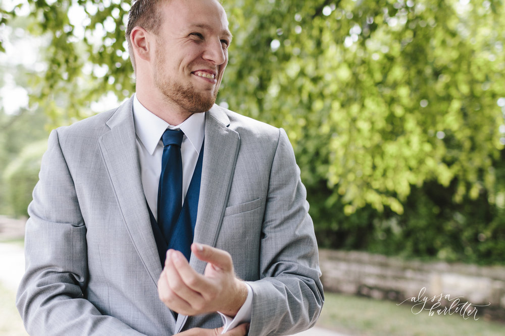 kansas city wedding photographer loose park plaza getting ready groom suit grey