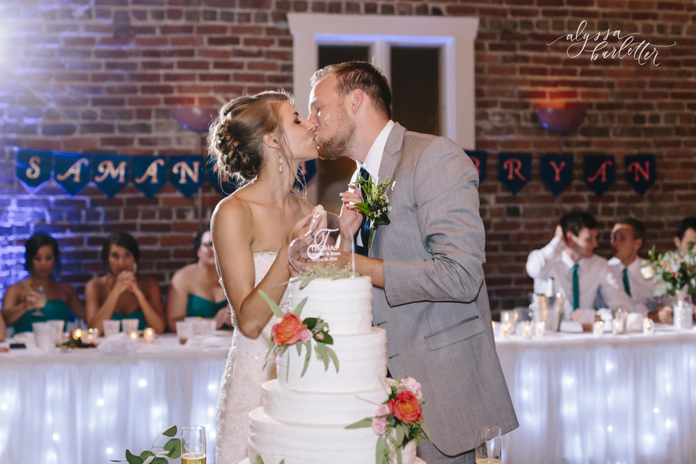 kansas city wedding photographer westport californos reception bride groom cake kiss