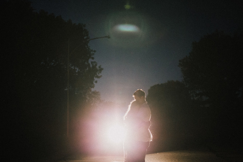 alyssa barletter photography artsy engagement photos headlight car nighttime fun-1.jpg