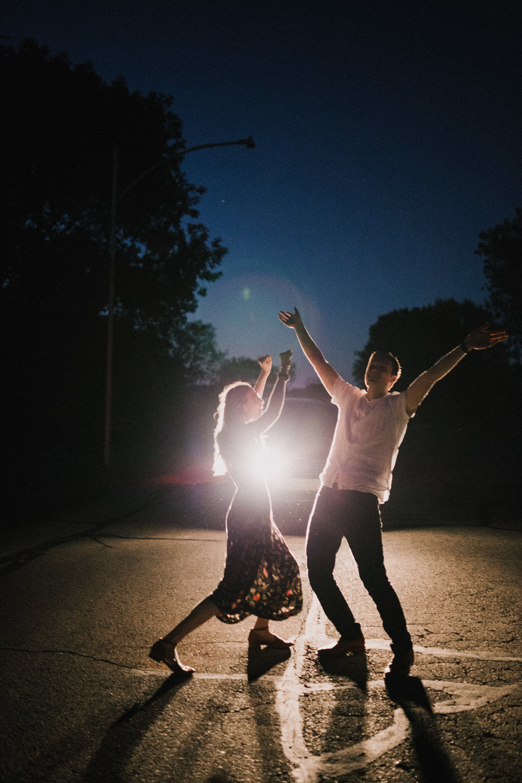 alyssa barletter photography artsy engagement photos headlight car nighttime fun-3.jpg