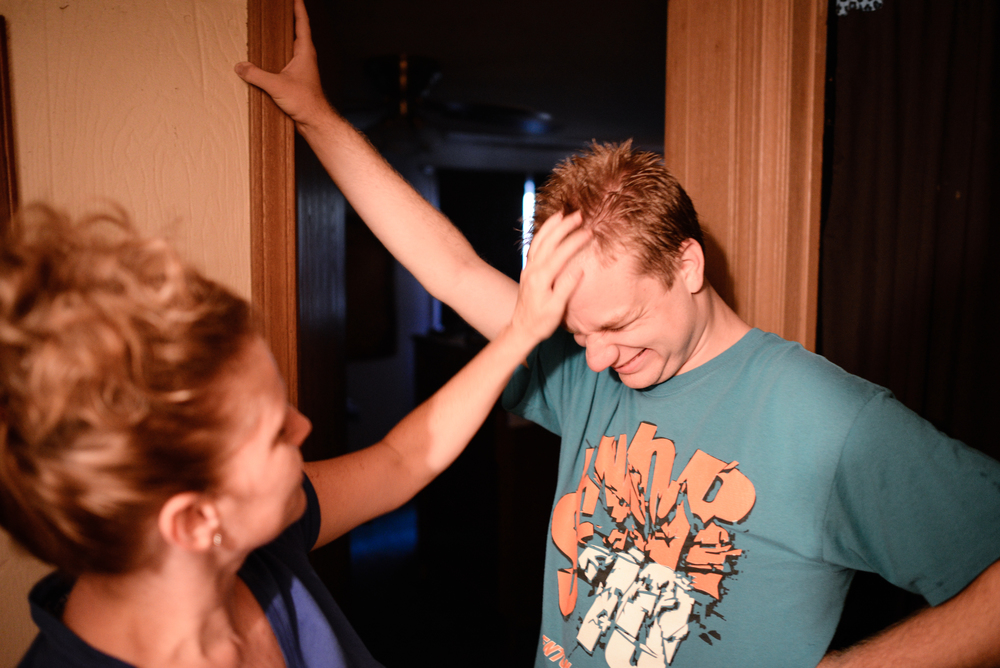 Trenton, Missouri. 2013.  Dalton's mother, Joyce, shows affection before she leaves for work in the morning.