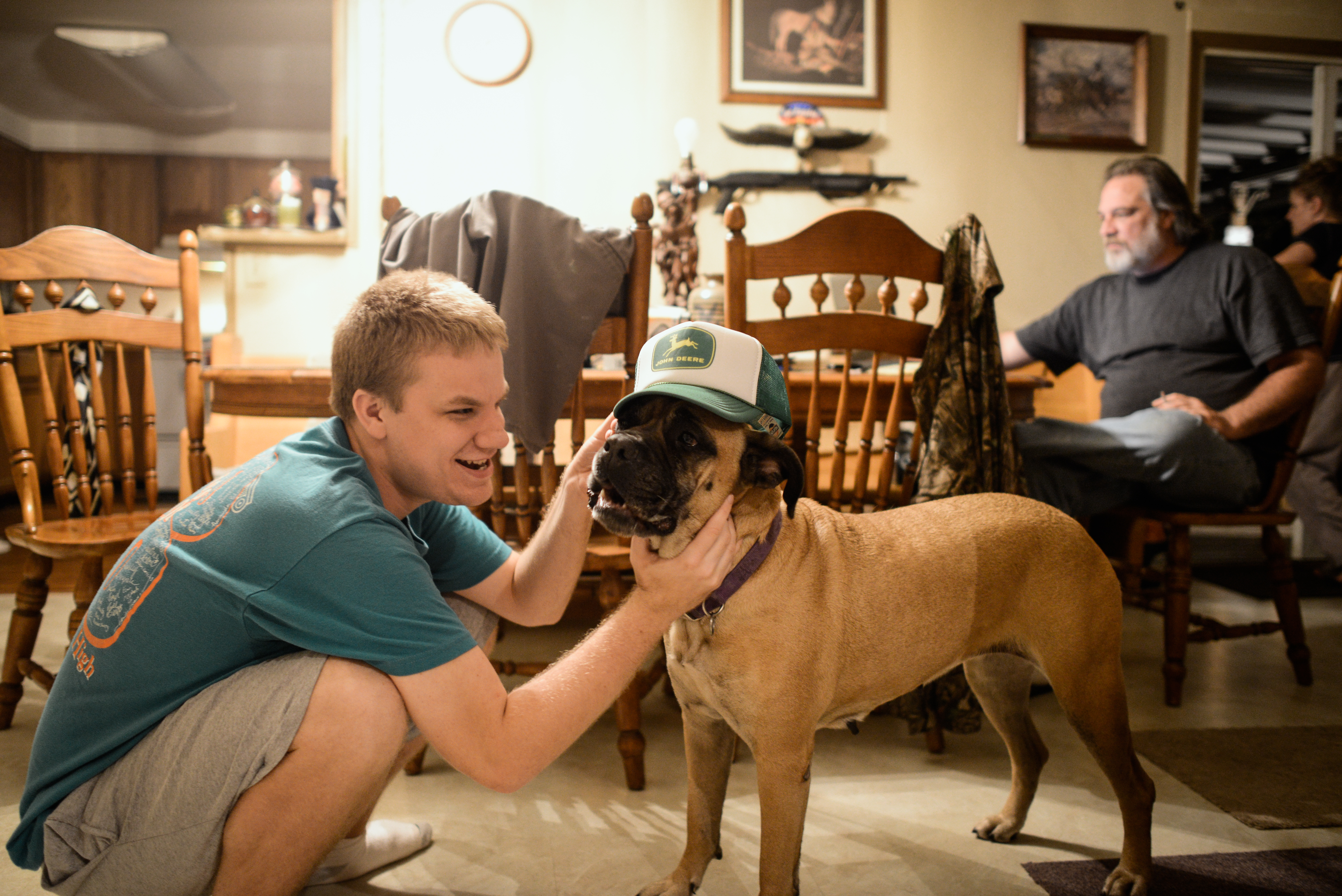 Trenton, Missouri. 2013.  Dalton shares a playful moment with his family dog, Roxy. The family dogs are a source of comfort for him.