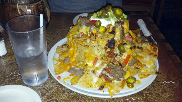 Chili, Shredded Cheese, Nacho Cheese, Guacamole, Sour Cream, Jalapenos, Tomatoes, Scallions, and Steak.