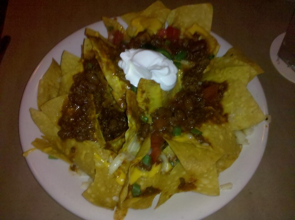 Pepper Jack Cheese, Bison Chili, Fresh Jalapenos, Tomatoes, Scallions, Sour Cream, Nacho Cheese.