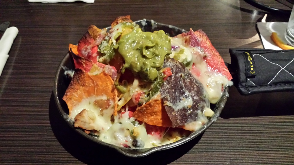 Tri color tortilla chips, cilantro black bean and corn salsa, bacon, chicken, jalapenos, pepper jack cheese, guacamole