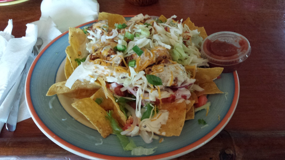 Crisp Nacho Chips, Blackened Tuna, Cheese, Greens, Cabbage, Red Onion, Tomato, Scallions, Lime Sour Cream, Salsa
