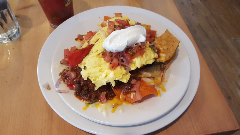 Tri color tortilla chips, jack cheese, bacon scramble, sour cream, salsa fresca, chili