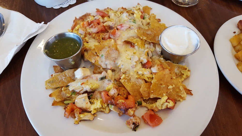 Scrambled Eggs, Chicken, Tortilla Chips, Tomatoes, Green Onion, Pepperjack Cheese, Salsa Verde, and Sour Cream. Served with Brunch Potatoes and your choice of Toast or Pancakes.