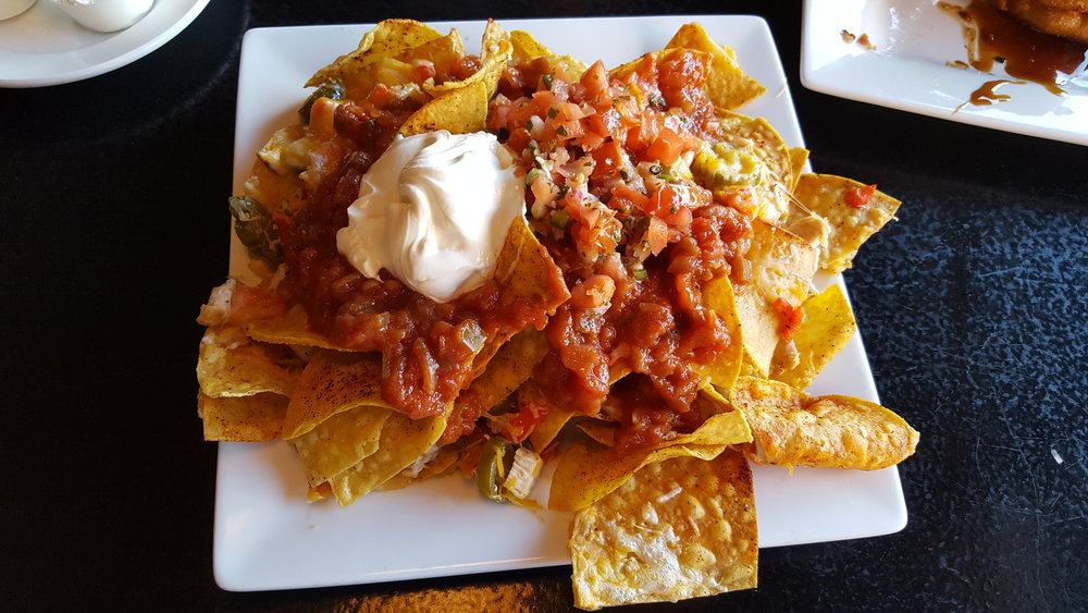 Fresh corn tortilla chips, jack cheese, roasted red peppers, sliced jalapenos, sour cream, fresh salsa, chicken