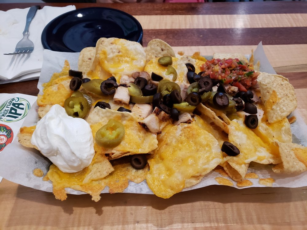 Tortilla Chips, Cheddar Jack Cheese, Salsa, Jalapenos, Black Olives, Cilantro Lime Sour Cream