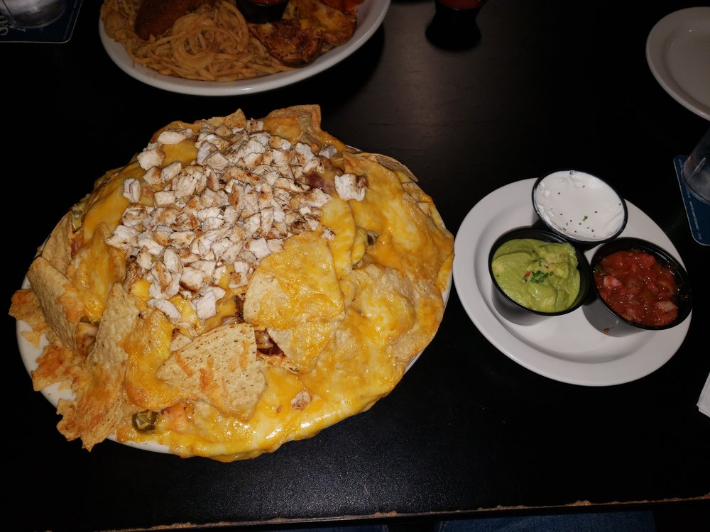 Tortilla Chips, Melted Cheese, Diced Tomatoes, Black Olives, Jalapeños, Sour Cream, Salsa, Guacamole, Chicken, Chili