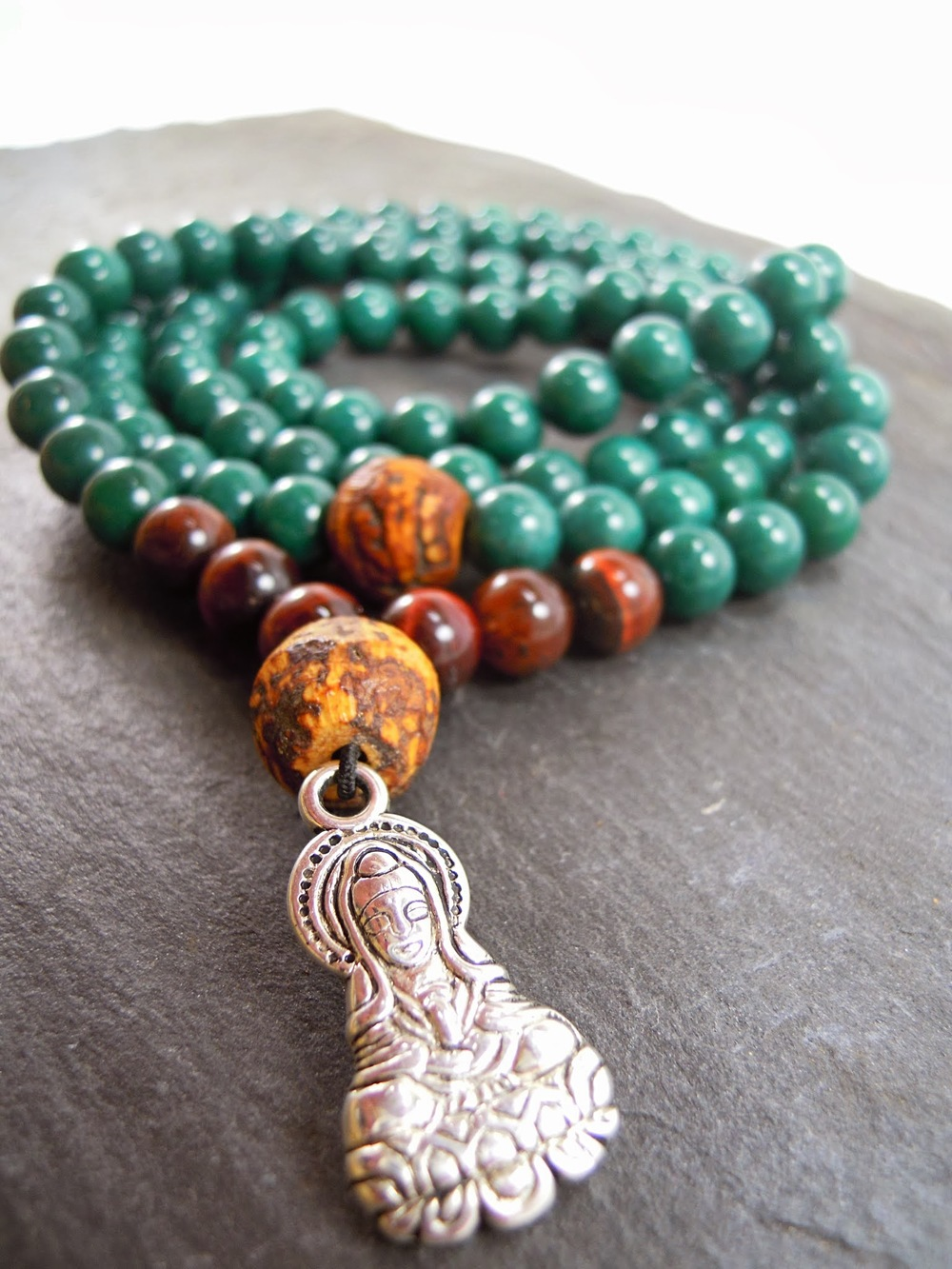 NOW AVAILABLE! Pursuit of Compassion Mala - Mountain Jade, Red Tiger Eye, Bohdi seed, and   Avalokiteśvara, the  bodhisattva of compassion.
