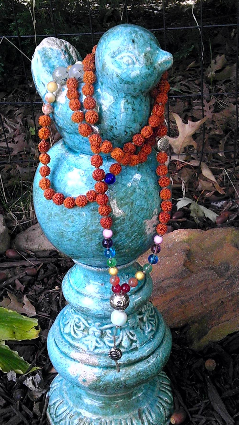 Chakra Balance Mala with Rudraksha...this is a custom made mala I made a couple of years ago.  This picture is from one of my shade gardens.