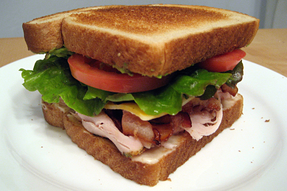 TURKEY CLUB SANDWICH  Lettuce, Tomato, Onion, Bacon & Cheese.