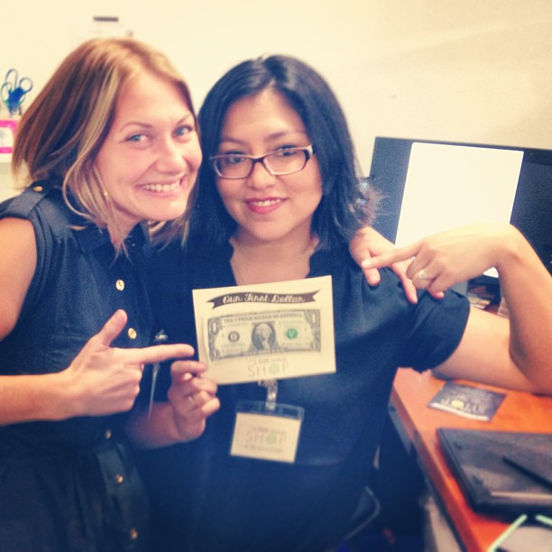 Eva and Danielle celebrate their first dollar.