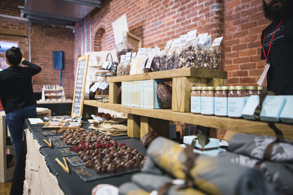 French Broad Chocolate uses shelves to display products at different levels