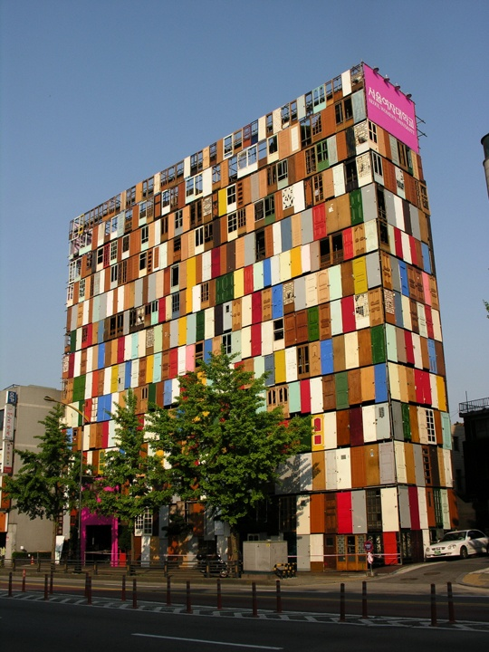 What a project. A 1000 old doors create this colorful and happy building.